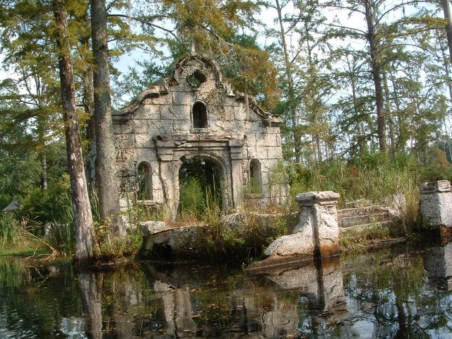 ruins of a building in a cypress swamp.