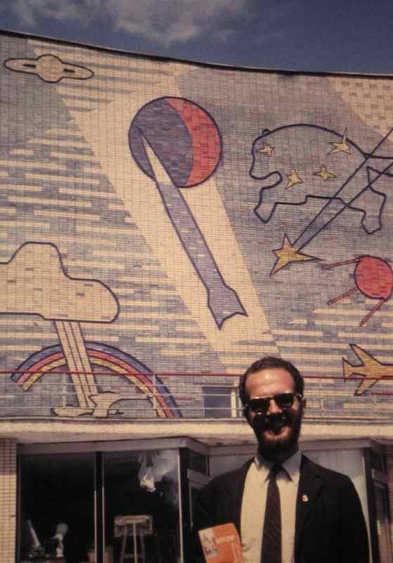 photo of Bill Hunter in front of colorful mosaic building front in Moscow