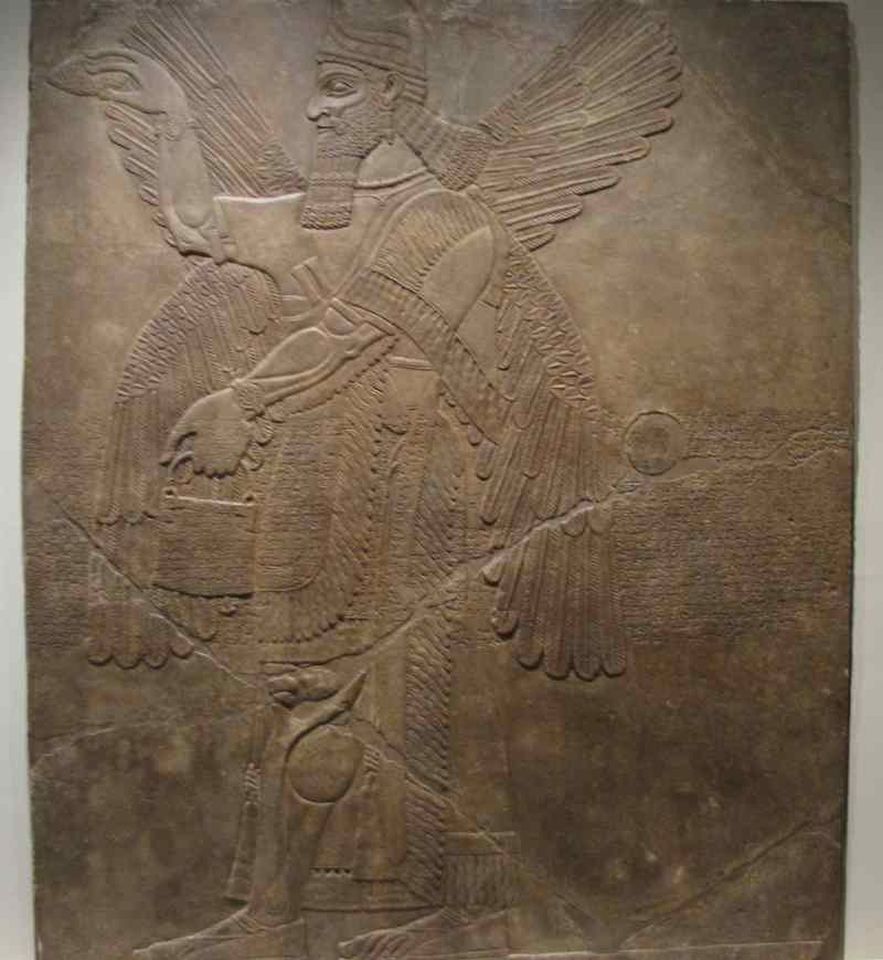photo of Assyrian relief carving of man with wings