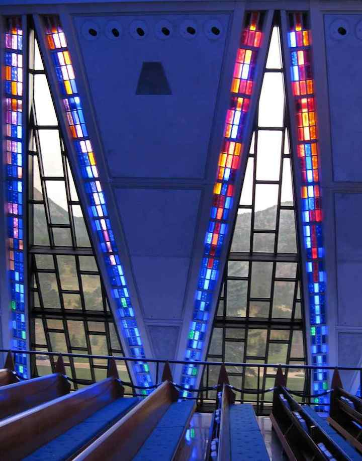 photo of view inside Cadet Chapel USAF Academy looking through windows to mountains.
