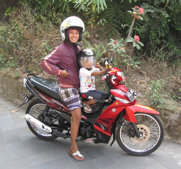 Women with her son on motocycle