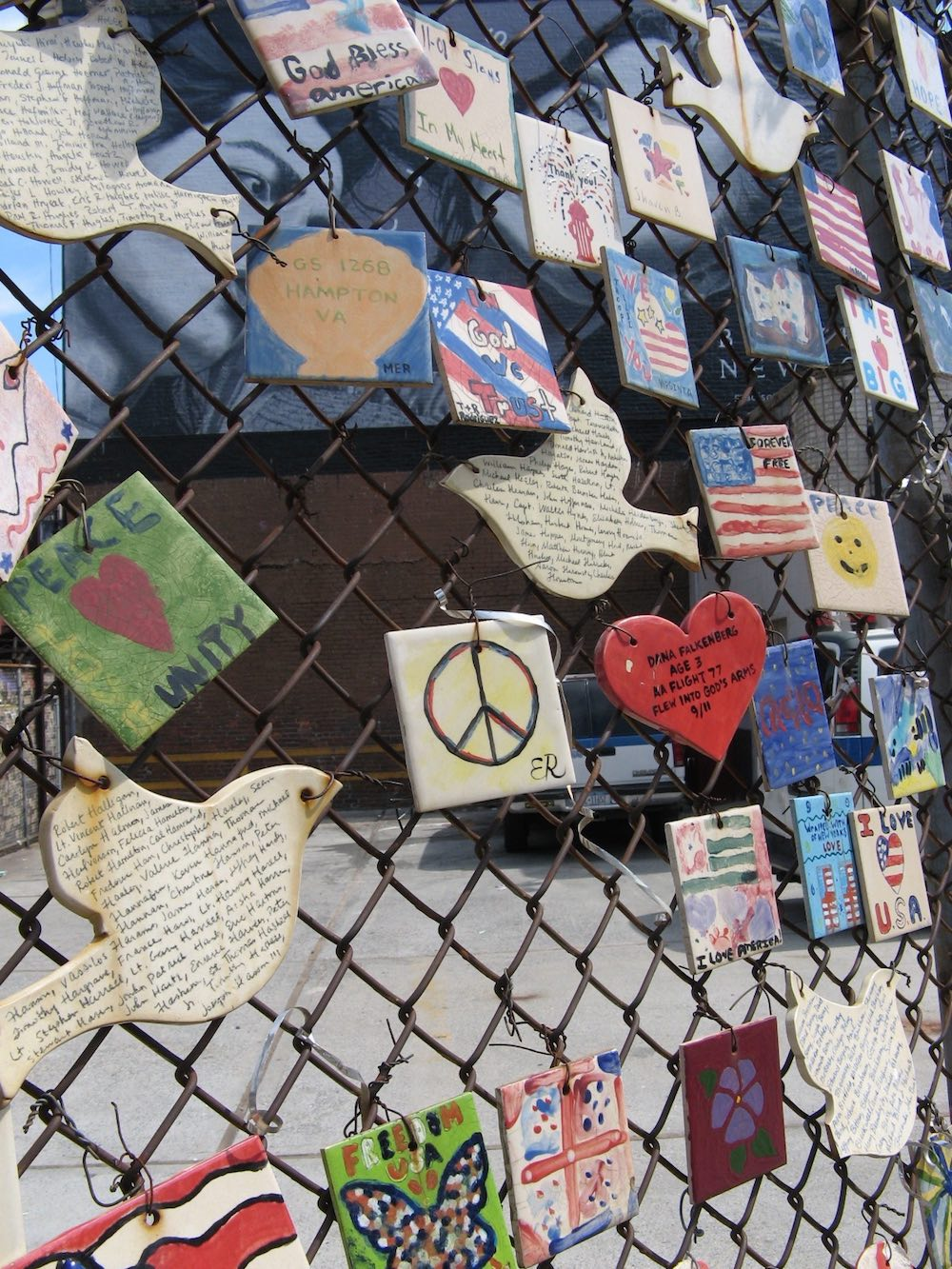 tiles people left on a face as a memorial to 9-11