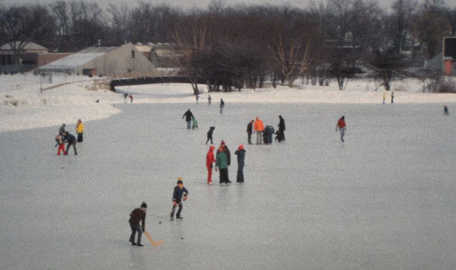 a bunch of people on a frozen waterway