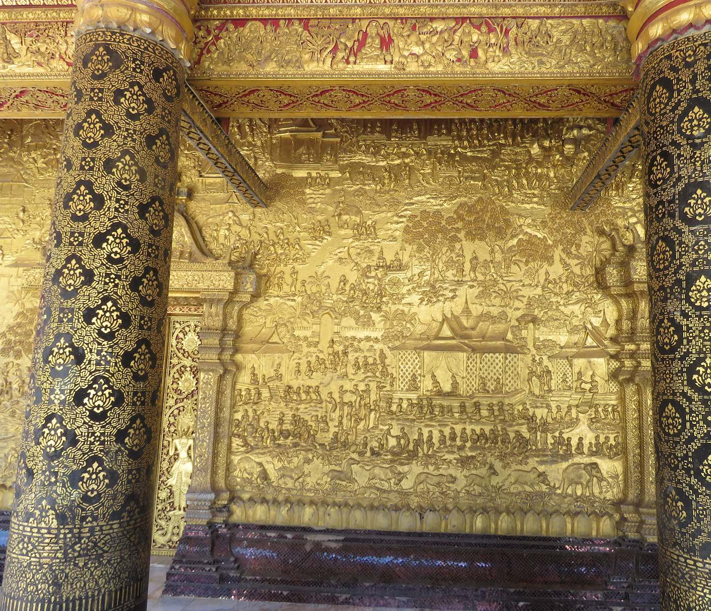 Outside golden wall with relief art