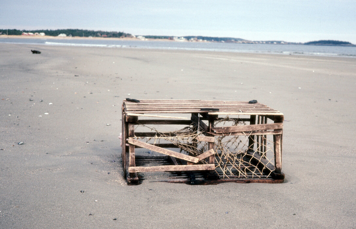 wooden crab trap on beach in maine